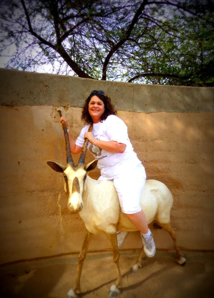 Jodie wrangling an oryx (fake)